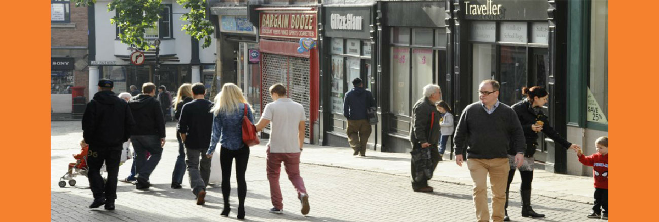 Slider image showing shoppers walking down cobbled shopping street in Sheffield, Lane Walker Chartered Surveyors and Commercial Property Agents