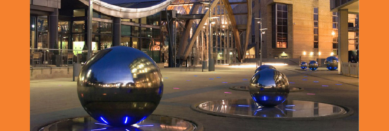 Slider image showing spherical metal street furniture in Sheffield, Lane Walker Chartered Surveyors and Commercial Property Consultants